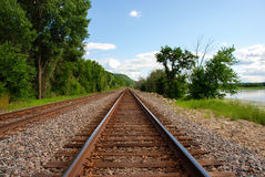 Rails run away into the distance. Railroad along the Mississippi River Stock Image