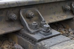 Rails and sleepers with rusted hardware close-up stock photo