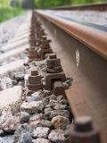 Rails stretching into the distance Stock Photo