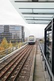 Rails and a subway train over the ground in Copenhagen Stock Photography