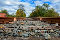 Rails under the sun rail road travel station subway. Rails waiting for the road railway rails Stock Image