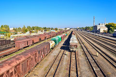 Rails and waggons. A perspective view of station with set of parallel rail lines with wagons Stock Photography