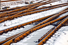 Rails in winter at the station Royalty Free Stock Image