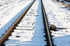 Rails in winter at the station Royalty Free Stock Photo