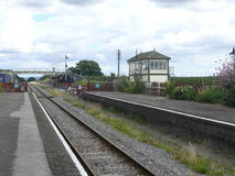 Railtrack to the Past. Desertyed railway station with the track stretching out to infi8nity Stock Images
