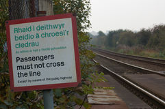 Railway 01. A sign indicating that passengers must not cross the railway lines Stock Photos