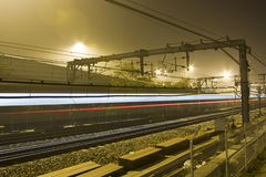 Railway. Rails by night with reflecting neon light Stock Photo