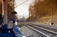 Railway. Tracks with curve and barrier system with bell Stock Images