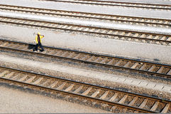 Railway. Walker on the railway line inspections royalty free stock photo