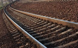 Railway. A pair of railway tracks in a bend Royalty Free Stock Photos