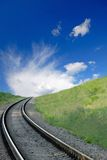 Railway. And  dark blue sky with white clouds, spring Stock Photo