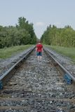 Railway. A very young boy on a railway Royalty Free Stock Photo