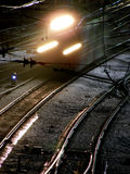 Railway. The locomotive on the rail crossing at night Royalty Free Stock Images