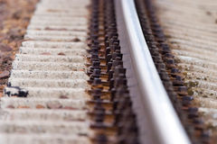 Railway. Brown screws on railway without train Royalty Free Stock Images
