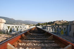 Railway. A perspective of a railway crossing a bridge Stock Images