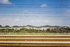 The railway across the city. The rail across the city under blue sky Royalty Free Stock Image