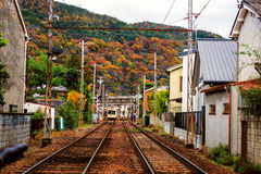 Railway in Arashiyama urban city at autumn Stock Photos