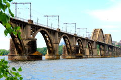 Railway arched bridge across the Dnieper River in Dnipro city, Ukraine. Stock Images