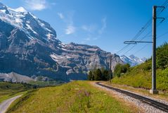 Railway on the background of Jungfrau mountain in the mountains of Switzerland stock images