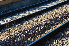 Railway background and stones. Railway lines and small stones, under the sunrays, in Treviso train station, Veneto, Europe Stock Images
