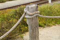 Railway Barrier. Rope and Post railway barrier Royalty Free Stock Photo