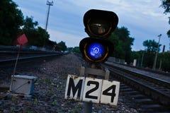 Railway blue traffic light Royalty Free Stock Photo