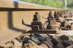 Railway bolt. Bolt macro on a railway line royalty free stock photo