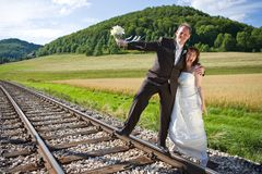 Railway and bridal couple stock photo