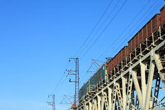 Railway bridge. And goods train Royalty Free Stock Photography