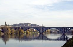 Railway bridge. Long railway bridge over river in daytime Stock Photo