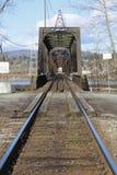 Railway Bridge. An old metal railway bridge crosses the Fraser River in British Columbia's Fraser Valley area Stock Image