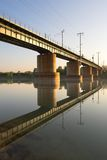 Railway bridge. The shot was taken in the early morning, the reflection of the bridge can be seen in the water Stock Photos