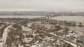Railway bridge above Dnieper river in Dnipro city. Aerial top view from drone on railway bridge above Dnieper river in Dnipro city. Winter landscape and stock images