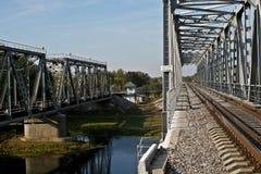 Railway bridge across the river in autumn. Stock Photos