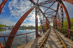 Railway bridge. Across the river photographed using a fisheye lens Royalty Free Stock Image