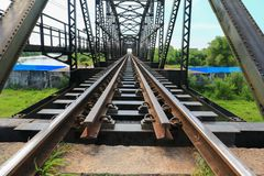 Railway bridge across the river select focus with shallow depth of field.  Stock Photo