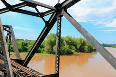 Railway bridge across the river select focus with shallow depth of field.  Stock Photography