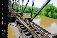 Railway bridge across the river select focus with shallow depth of field Royalty Free Stock Photo