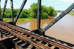 Railway bridge across the river select focus with shallow depth of field Royalty Free Stock Image