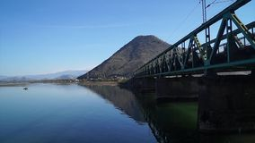 Railway bridge across the river sunny summer day. Mountain steel railroad stock video