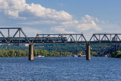 Railway bridge across the river on which the train is traveling royalty free stock photo