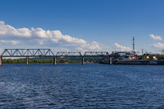 Railway bridge across the river on which the train is traveling royalty free stock photography