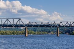 Railway bridge across the river on which the train is traveling Stock Photo