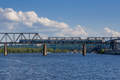 Railway bridge across the river on which the train is traveling Stock Photos