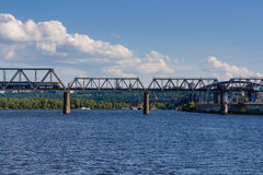 Railway bridge across the river on which the train is traveling stock photography