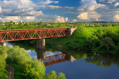 Railway bridge across small river in sunny summer day Stock Photography