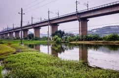 Railway bridge across village Stock Photos