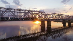 Railway bridge across the Volga river, which goes to a freight train. Aerial view stock video footage