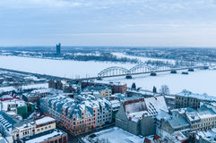 Railway bridge across winter-time Daugava river. Winter cityscape and railway bridge across Daugava river, Riga, Latvia Stock Images