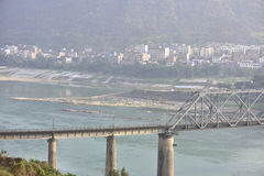 Railway bridge across the Yangtze river and the small town of scenery Royalty Free Stock Image